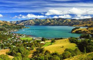 French Akaroa sitting pretty surrounded by water.